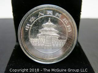 1999 PANDA SILVER 1 TR OZ COIN