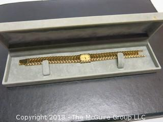 LADIES GOLD TONED BULOVA WATCH