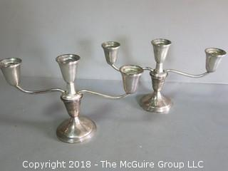 Pair of sterling weighted table candleabras