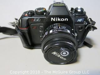 Nikon N2020 AF Camera with AF Nikkor 50mm 1:1.8 and Toshiba 52mmUV lens filter (Description altered 2018-07-12 at 12:50pm.  If you wish to retract a bid, contact me)