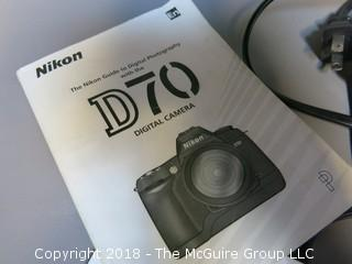 Nikon D-70 with Nikon AF Nikkor 18-35mm lens (Description was altered 2018-07-11 at 12:46pm.  If you wish to retract a bid, contact me).