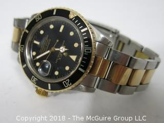 """1980 ROLEX Oyster Perpetual Date """"Submariner"""" 1000 ft. Chronometer with Steel/18k Gold Two-Toned Band; Black Dial; Case #16800; (Note: most cases for this watch were made using Case ##16803); {Description Altered: 11-7-2018 at 11:15am ET} SERIAL # 6458717"""