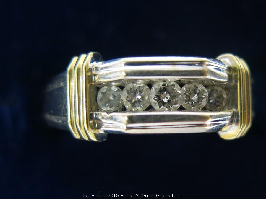 The McGuire Group LLC - Auction: Fine Jewelry On-Line Auction ITEM: Men's 14K Two-Toned Gold Ring with 5 Channel Set Diamonds; total weight 12g