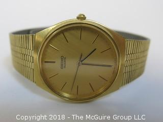 Seiko Quartz Men's Watch with Gold Toned Band