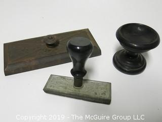 "Collection including handmade ""Olcott"" metal stamp; metal sanding block and lead weighted vase"