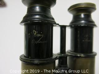 "Binoculars; words etched ""181 Strand; London"" and ""(illegible) Opticians"""