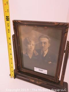 "Portrait of Couple in wood carved swivel frame; 12"" tall"