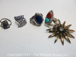 Collection of (4) sterling rings and brooch; sizes left to right in photo: 5 1/4;7;7 3/4;7