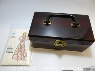 Vintage celluloid cosmetic case and Vogue dress pattern