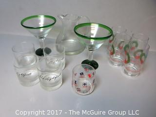 Collection of glassware including a pair of martini stems