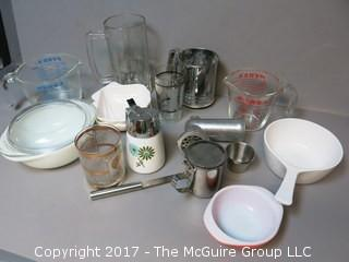 Collection of mid-century dishware including Corning, Pyrex, sifter and liter glass mug