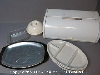 Collection including vintage tin bread box and set of (4) HALL oval plates