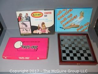 Collection including vintage board games, glass chess set and 1970's pull-up exerciser