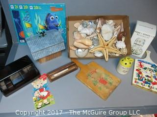 Collection including sea shells, vintage cutting boards, vintage Valentine's Day Card, (3) NIB Nemo puzzles and a botanical jar