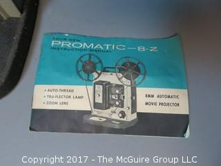Promatic Model 8-Z 8mm Automatic Movie Projector with instruction book and case