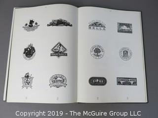 """Book Title: """"100 Years of World Trademarks: Symbol and Logotype Designs; Vol. I and II; Edited by Rick Eiber; Creative Director B. Martin Pedersen; published by The Graphics Press Corp.; 1996  WILL SHIP"""
