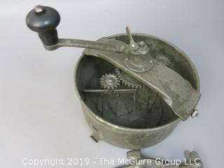 Hand cranked mixer; marked on base; includes counter bracket