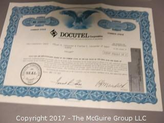 Collection of 45's and stock certificates