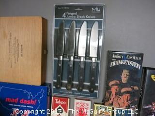 Collection including playing cards, cigar boxes, fishing tackle, keepsake box, Army backpack, NIB knife set and SHARP calculator