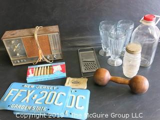 Collection including milk bottle, NJ license plates, wooden dumbell, (3) sofa fountain ice cream sundae glasses, kitchen grater and Zenith Radio