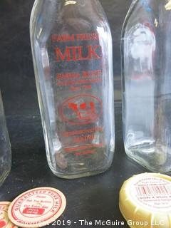 (2) Kennebunkport, ME quart milk bottles and numerous bottle caps