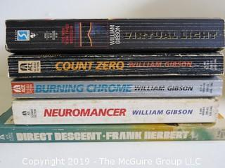 Collection of books including including authors William Gibson and Frank Herbert