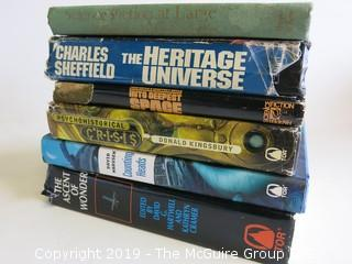 Collection of books including authors Charles Sheffield, Donald Kingsbury and David Harusek