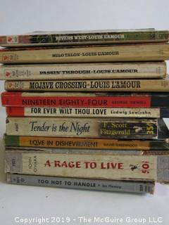 Collection of books including authors Louis L:'Amour, Orwell, Lewisohn, F. Scott Fitzgerald, David Greenwood, John O'Hara and Ian Fleming