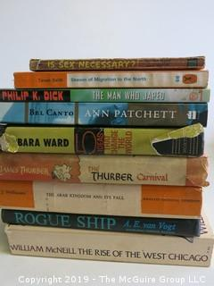 Collection of books including authors Philip K. Dick, Ann Patchett, Barbara Ward, James Thurber and A.E. van Vogt