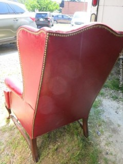 Red Leather Wing Back Chair (Note: needs some re-stitching; bottom wooden stretcher has been re-glued)
