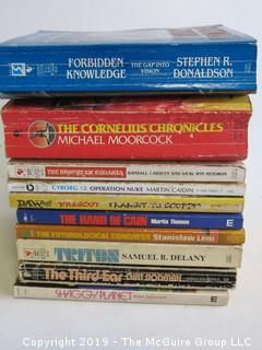 Collection of books including authors Donaldson, Moorcock, Garrett and Heydron, Caiden, Prescot, Martin Thomas, Delany, CurtSlodmak and Ron Goulart