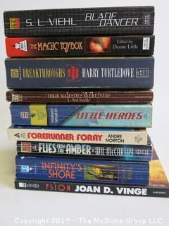 Collection of books including authors S.L. Viehl, Denise Litytle, Harry Turtledove, Norman Spinrad, Andre Norton, Wil McCarthy, Daniel Brin and Joan D. Vinge