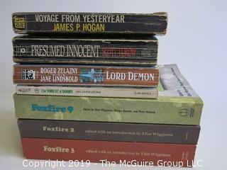 Collection of books including authors Turow, Livingstone, Hogan and Lord Demon