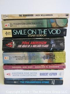 Collection of books including authors Williamson, Silverberg, Anderson, Dickson, Asprin and Wilson