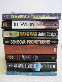 Collection of books including authors THaldeman, Caine, Scalzi, Ben Bova, Stross, Sheffield and Reynolds