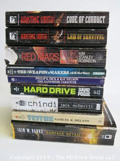Collection of books including authors Kristine Smith, K.S. Robison, A.E. van Vogt, Dick, Pogue, McDevitt, Delany and Iain M. Banks