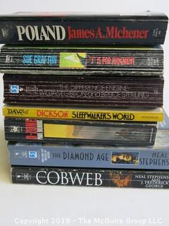 Collection of books including authors Grafton, Gibson and Sterling, Dickson, Stephens, Frederick George and Theroux