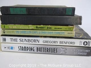 Collection of books including authors Raymond F. James, Jon Courteney Grimwood, Gregory Benford, Goulari and Phillip Atleee