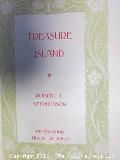 "(4) Books: ""Walden"", by Henry D. Thoreau; copyright 1910 by Thomas Y. Crowell and Co.; ""Treasure Island"" by Robert Lewis Stephenson, published by Henry Altemus, Philadelphia; ""Murders of The Rue Morgue"" by Edgar Allen Poe,  printed and bound by Trow's, New York and published by John W. Lovell Co., New York;  ""The Age of Fable"" by Thomas Bulfinch, published by S. W. Titlon, Boston; 1881"