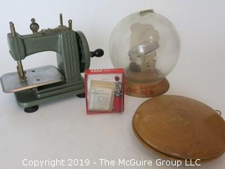 "Collection including an oversized wooden yo-yo, a vintage savings bank, and a miniature ""Betsy Ross"" sewing machine"