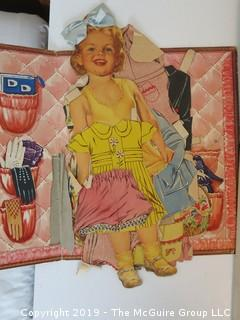 Collection including Doris Day doll cutouts and David Levine Caricatures