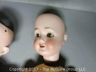 Two bisque head German dolls (see all the photos)