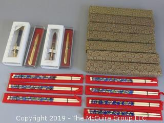 Collection of (7) sets of chopsticks with presentation boxes; (4) NIB ballpoint pens