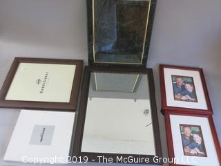 Collection of picture frames, wall mirror (frame damage) marbleized certificate holder and  Pierre Cardin lace set