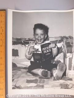 Large Format B + W Photo of Toddler reading Peyton Place Book