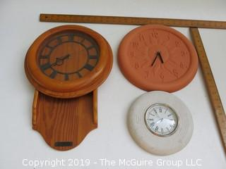 (3) battery operated wall clocks