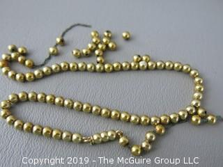"13"" 14k gold baby beads; strung on non-gold chain; needs to be restrung; 10.2g"