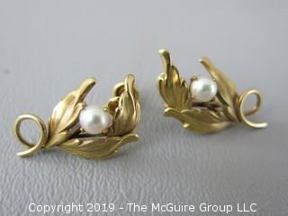 Pair of 14k gold clip on earrings set with single pearls; 4.5g