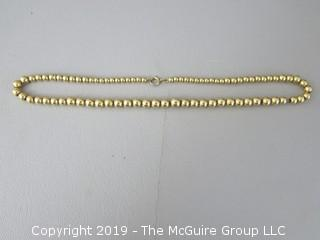 "16 1/2"" string of graduated faux gold beads"