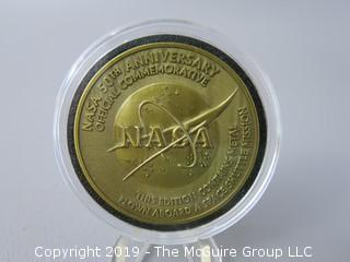 NASA 50th Anniversary Official Commemorative medallion, containing metal flown aboard a space shuttle mission
